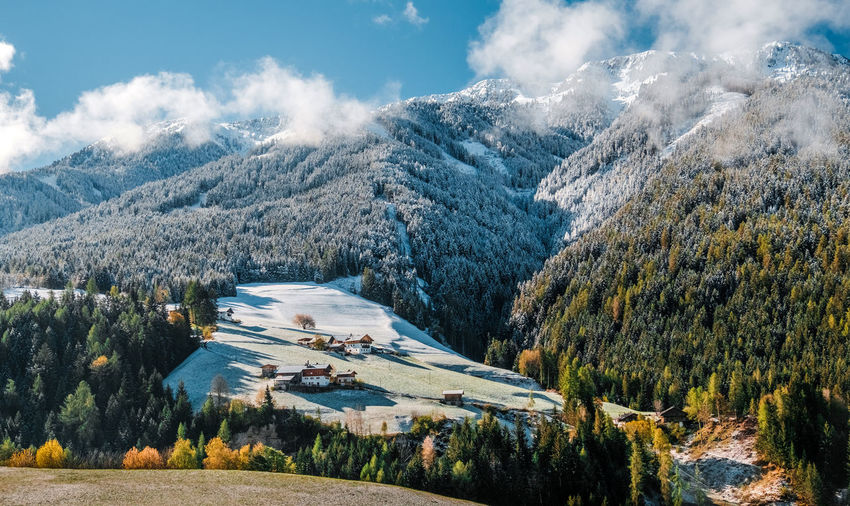 Aerial view of snowcapped mountains against sky in dolomite alps, italy.