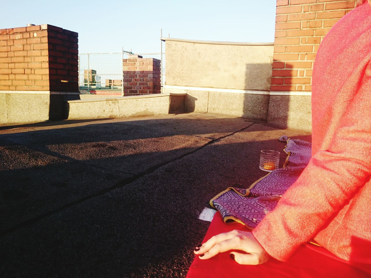 Woman Sitting On Roof Of Building