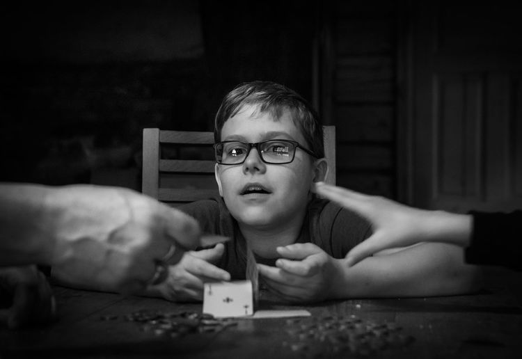 Portrait of boy playing card game