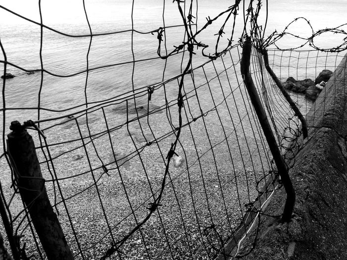 climb the walls Isolated Industrialization Constriction Constricted Out Of Reach Fence Beach Outdoors Day Sea Industrial Nature Vs Concrete Nature Vs City Urban Rust Fence Wire EyeEmNewHere Tranquility Tranquil Scene Scenics Go Higher Plastic Environment - LIMEX IMAGINE