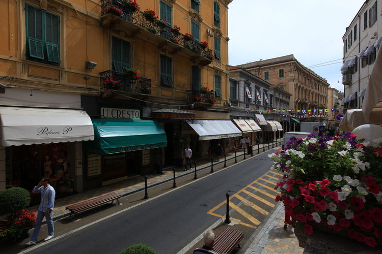 San Remo, Italy San Remo Architecture Building Exterior Built Structure City Day Flower Italy Men Outdoors People Real People Road Sky Street Walking Women