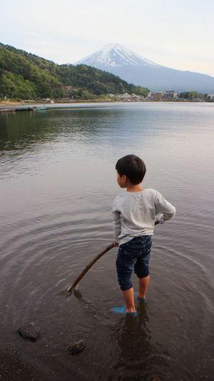 Rear view of boy in lake