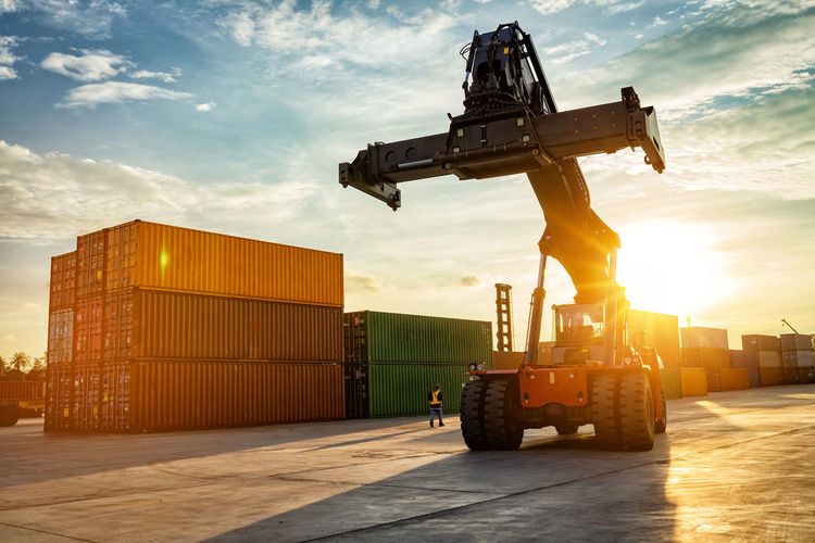 Thailand Laem Chabang Chonburi Industrial logistic forklift truck containers shipping cargo in port at sunset time. Adults Only Construction Machinery Day Forklift Forklift Truck Forklift With Sunset Industry Loading Logistics Mode Of Transport One Man Only One Person Outdoors People Silhouette Sky Sunset, Transportation