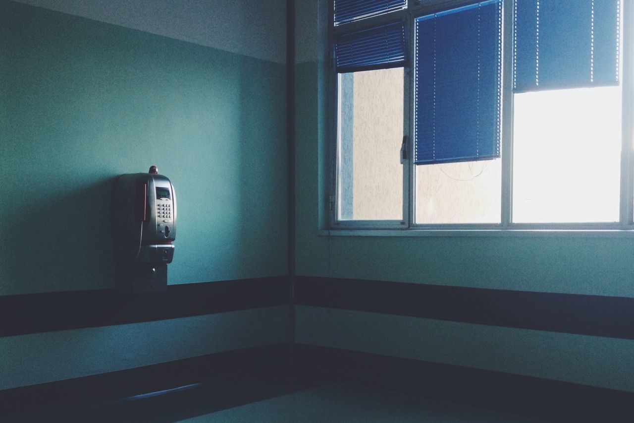 Telephone mounted on wall in empty room