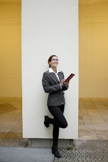happy businesswoman with digital tablet Accessibility Beautiful Business Businesswoman Communication Connect Digital Tablet Full Length Glasses Happy Laughing Livestyle Manager Network One Person Optimistic Smiling Social Media Successful Tablet Tablet Pc Technology Text Messaging Wireless Technology Woman