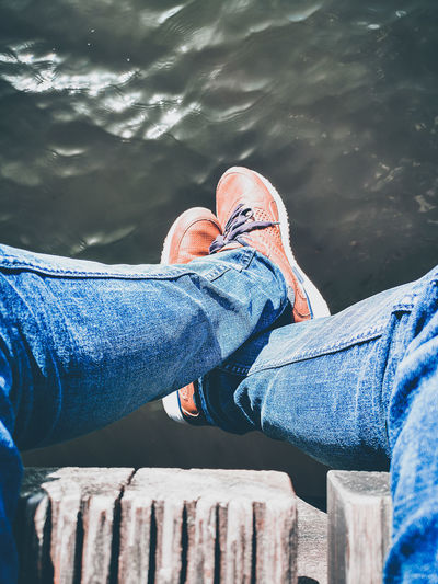 Low Section Water Men Human Leg Sitting Shoe Young Women Human Foot Limb Close-up Foot Leg Feet Toe Sportsman Legs Crossed At Ankle Personal Perspective Sports Shoe Sole Of Shoe Sole Of Foot