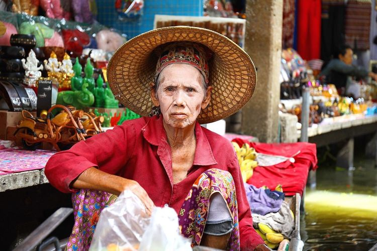 Portrait Of Senior Vendor Wearing Conical Hat