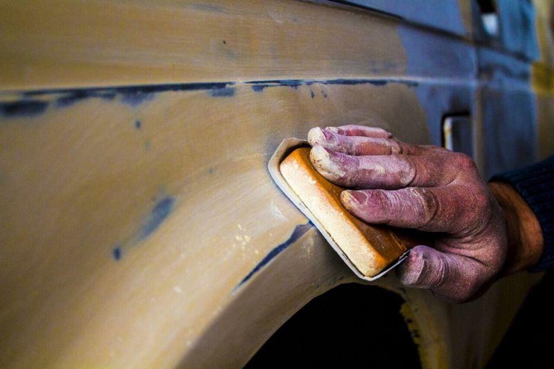 Copped Hand Polishing Car
