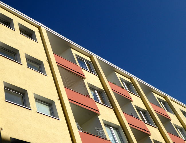 Apartment Architecture Balcony Building Exterior Built Structure City Clear Sky Colourful Facade Copy Space Façade In A Row In Berlin Germany Low Angle View Modern No People Residential Building Social Apartment Building Sociale Wohnungs Bau Sunlight Window