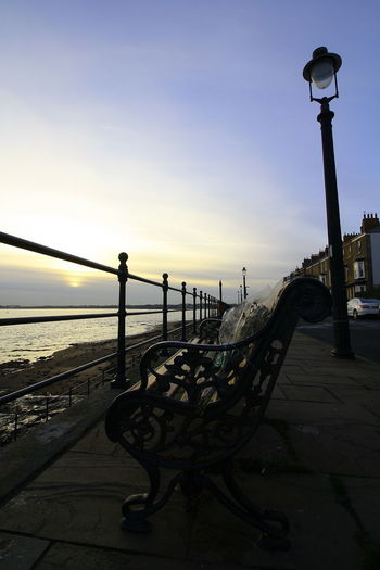 OUT AND ABOUT IN HARTLEPOOL Sky Street Light Street Architecture Railing Sunset Nature Built Structure Metal Water Lighting Equipment No People Outdoors Bench City Dusk Building Exterior Pier Footpath Promenade Park Bench