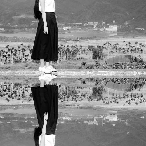 Reflection Of WOMAN STANDING ON SHORE