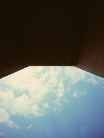 Between Architecture Blue Blue Sky City Cloud - Sky Clouds Day Low Angle Low Angle View No People Outdoors Sky Wall