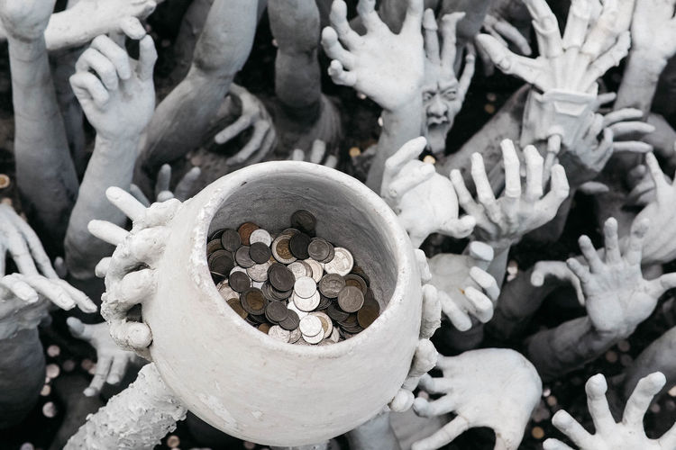 Devils are ravish the coins Close-up High Angle View Bone  Human Skeleton Skeleton Sunlight Large Group Of Objects Statue Belief Creepy Coins Thai Coins
