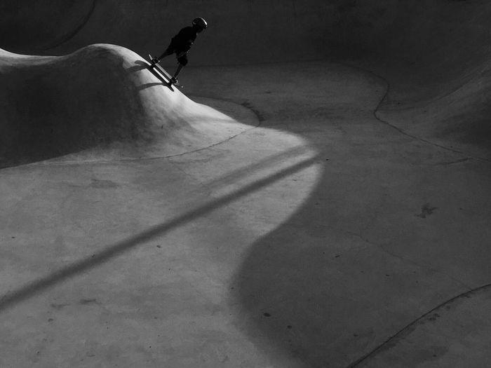Person skateboarding at skateboard park