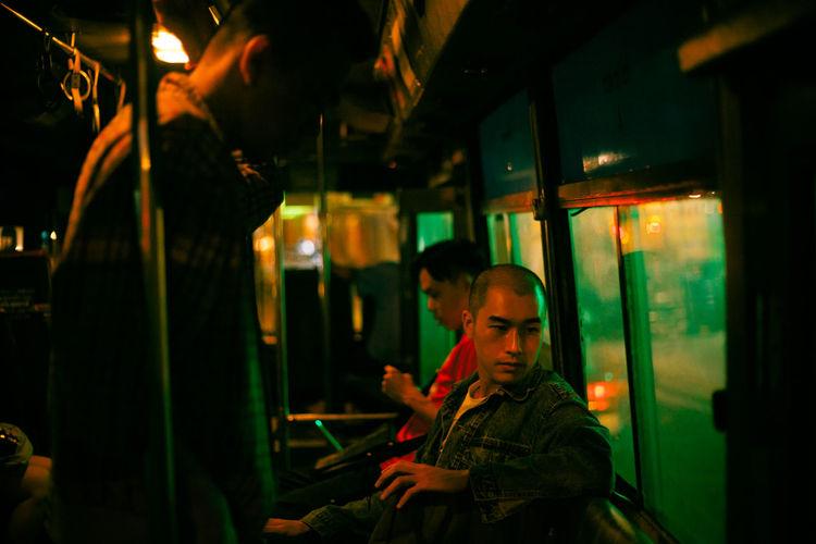 Full length of man sitting in train