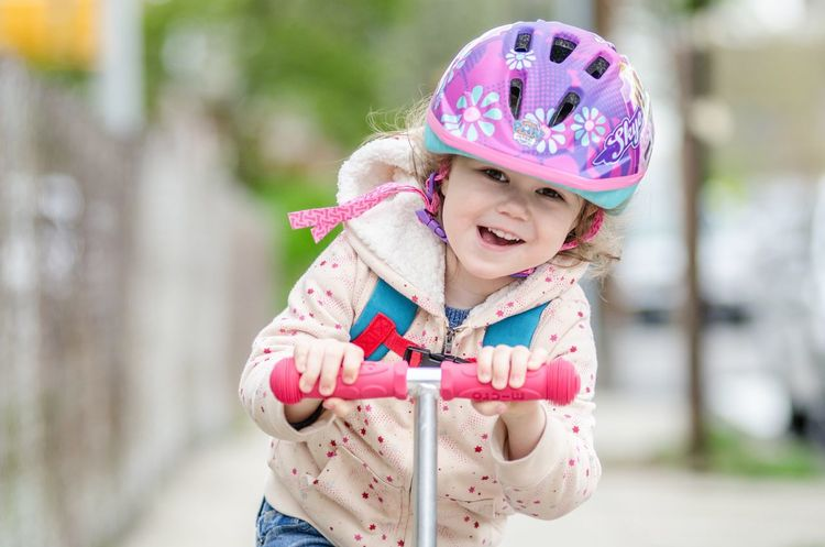 Smiling Childhood Girls Happiness Cute Outdoors Mouth Open Cheerful Focus On Foreground Day One Person Enjoyment Child Portrait Children Only Headwear Safety Helmet