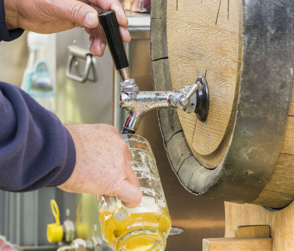 hand at beer tap pouring a draught beer Adult Adults Only Close-up Day Human Body Part Human Hand Only Men