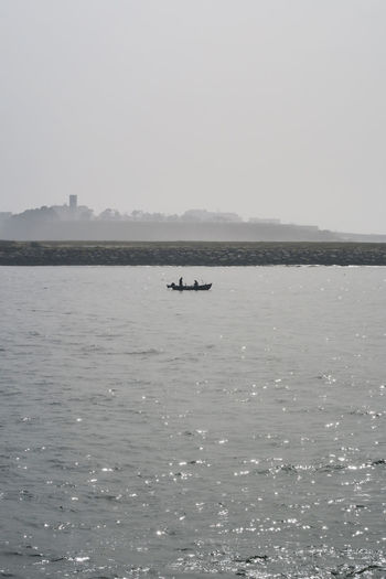 small fishing boat in the harbour of porto, douro river atlantic ocean Grey Fog Fishing Boat Coast Atlantic Ocean Harbour Still Water Morning Porto Douro River Dark Calm Lonely Minimal Humpback Whale Whale Swimming Water Sea Sea Life Nautical Vessel Animal Themes Sky Horizon Over Water