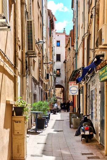 Perpignan, France - April 8, 2016: Charming narrow street in old town of Perpignan in springtime. Pyrenees-Orientales, France Architecture City Editorial  Exterior France Landmark Languedoc-Roussillon Midi-Pyrenees Narrow Street Old Town Outdoors Outdoors Restaurant Pedestrian Walkway Perpignan Pub Pyrénées-Orientales Roussillon Sidewalk Spring Street Travel Destinations Urban Landscape View Walkway Western Europe