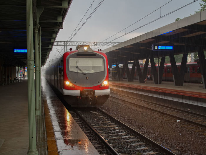 Rainy day modern train waiting station for passengers Architecture Arrival Built Structure Electricity  Illuminated Land Vehicle Mode Of Transportation Motion Nature No People Passenger Train Public Transportation Rail Transportation Railroad Car Railroad Station Railroad Station Platform Railroad Track Sky Station Track Train Train - Vehicle Transportation Travel