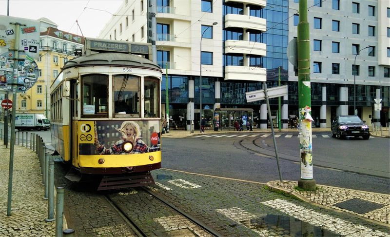 Lisbon Tram Architecture Building Building Exterior Built Structure Cable Car Car City City Life City Street Cobbled Incidental People Land Vehicle Mode Of Transportation Modern Vs Old Motor Vehicle Old Vs Modern Outdoors Public Transportation Rail Transportation Railroad Car Street Track Tram Tracks Transportation #urbanana: The Urban Playground Urban Fashion Jungle EyeEmNewHere