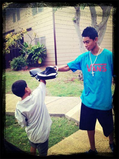 Letting the kids spar and train. Big bro teaching lil bro
