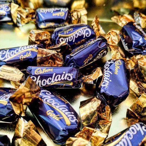 Close-up Chocolate Cadbury Eclair Candy Gold Eclairs