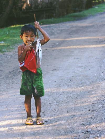 Full length portrait of boy walking