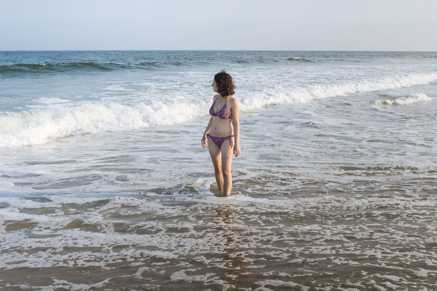 Relaxing Ankle Deep in the Water on a Summer Day in Long Beach Island Atlantic Ocean Clear Sky Lifestyle Nature New Jersey Standing Vacations Wave Woman Adventure Ankle Deep In Water Bathing Suit  Beach Bikini Day Gaze One Person Outdoors Personal Real People Sky Summer Waves