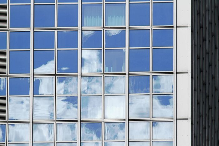 Architecture Backgrounds Blue Building Exterior Built Structure Clouds In The Windows Day Full Frame Low Angle View No People Outdoors Pattern Reflections Reflections In The Glass Windows Sky Window