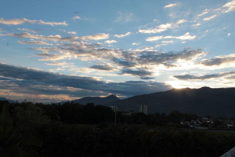 Mountain Sky Cloud - Sky Scenics - Nature Beauty In Nature Tranquility Sunset Nature Landscape Mountain Range Plant Outdoors Sunlight Mountain Peak Tranquil Scene Non-urban Scene Environment No People Idyllic Land Silhouette