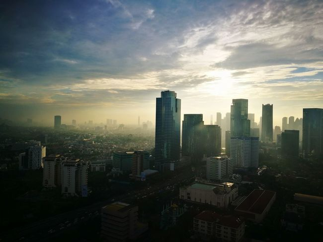 Afternoon at Jakarta City Cityscape Urban Skyline Modern Skyscraper Business Sunset Illuminated Downtown District Business Finance And Industry Financial District  Office Building Skyline Aerial View