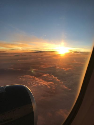 Traveling to Daytona, FL Window Seat Airplane Wing Window Seat Clouds And Sky Clouds Airplane Ticket Sunrise Air Travel  Airplane Air Vehicle Sky Sunset Transportation Mode Of Transportation Cloud - Sky Flying Scenics - Nature Jet Engine Window Engine Travel Mid-air Sunlight No People Nature Orange Color