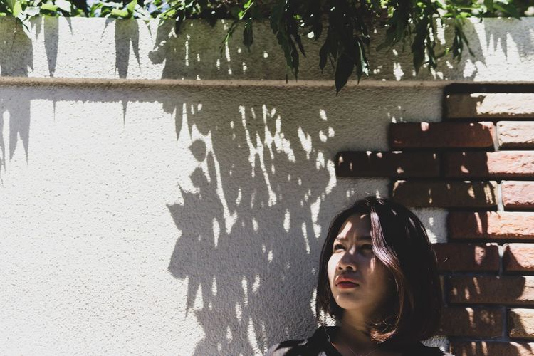 Light and shadow. Japan Portrait Of A Woman Travel Architecture Contemplation Emotion Front View Headshot Kobe Leisure Activity Lifestyles Nature One Person Outdoors Portrait Real People Shadow Sunlight Travel Destinations Tree Wall - Building Feature Women Young Adult Young Women