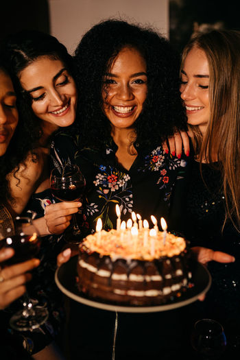 Four Birthday Birthday Cake Birthday Candles Cake Celebration Cheerful Enjoyment Females, Food And Drink Friendship Fun Happiness Indoors  Life Events Mixed Race Party - Social Event People Selective Focus Sweet Food Togetherness Toothy Smile Young Adult Young Women