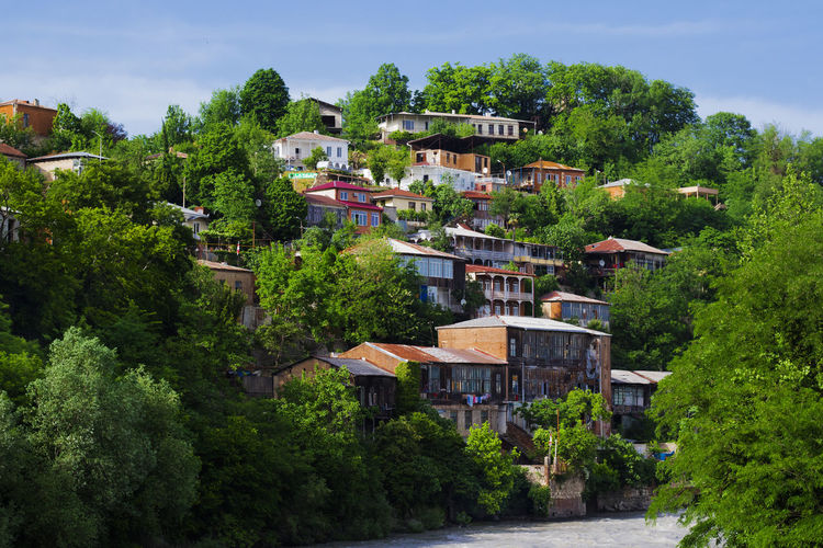 Georgia Kutaisi Travel Travel Photography View Architecture Blue Sky Building Building Exterior Built Structure City Day Day Light Green Color House Nature No People Outdoors Plant Residential District Roof Town Travel Destinations Tree View From Above Water