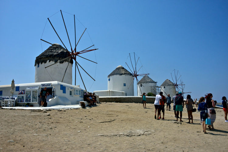 panoramic view with windmills and people Group Of People Sky Land Fuel And Power Generation Renewable Energy Wind Turbine Alternative Energy Turbine Large Group Of People Wind Power Environmental Conservation Crowd Architecture Real People Beach Nature Men Clear Sky Built Structure Day Outdoors Mykonos,Greece Windmills Greek Windmill Greek Architecture Highlights Tourism Tourism Destination Wind Wind Power Generator