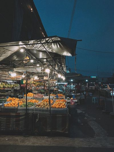 Streetphotography Streetdreamsmag Penang Malaysia Fruit Fruit Stall Traditional Market Market Market Stall Building Exterior Architecture City Built Structure Sky Nature Night Street Illuminated Outdoors No People Food And Drink