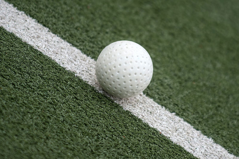 Activity At The Edge Of Ball Close To Close-up Day Grass Green - Golf Course Green Color High Angle View Hockey Hockey Ball Hokey Ball Hole Leisure Activity Match Ball, Game Point, Spot, Gull Nature No People Outdoors Plant Sport Summer Turf White Color