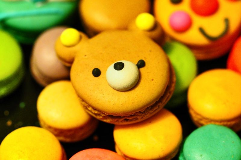 Full frame shot of anthropomorphic face on multi colored macaroons