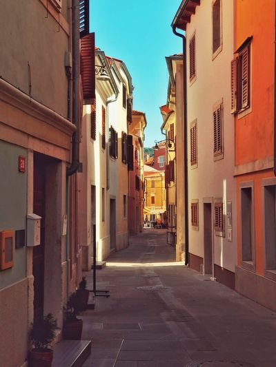 Streets of Izola Sea Town City EyeEm Gallery EyeEm Best Shots Eyeem Market Building Exterior Built Structure Architecture Building The Way Forward City Residential District Direction Street Sky Day No People House Sunlight Narrow Clear Sky Town Alley Outdoors Nature