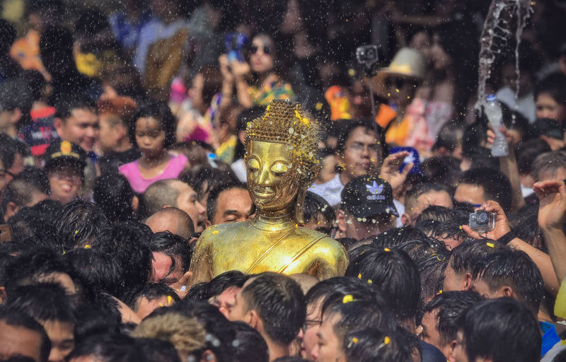 Buddha Statue Amidst People During Traditional Festival