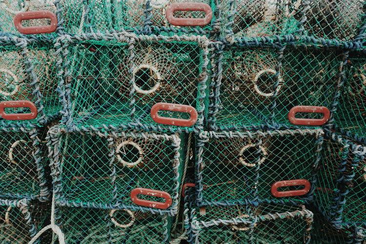 Full frame shot of stacked lobster traps at harbor