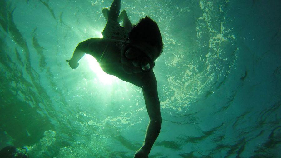 Silhouette woman swimming in sea