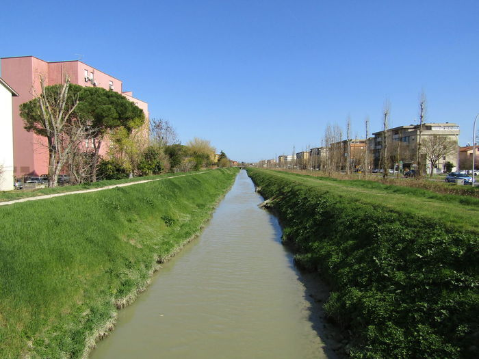 A canal in ravenna italy seen in perspective