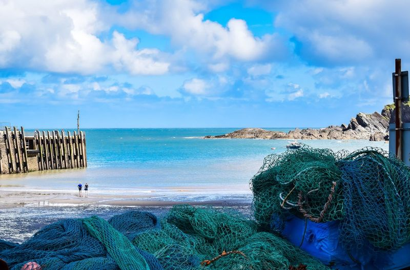 Beach Beauty In Nature Cloud Cloud - Sky Cloudy Coastline Day Fishing Net Grass Harbour Horizon Over Water Idyllic Nature Nets Outdoors Scenics Sea Seascape Shore Sky Tranquil Scene Tranquility Vacations Water