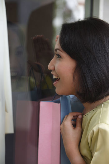 Woman looking at store window