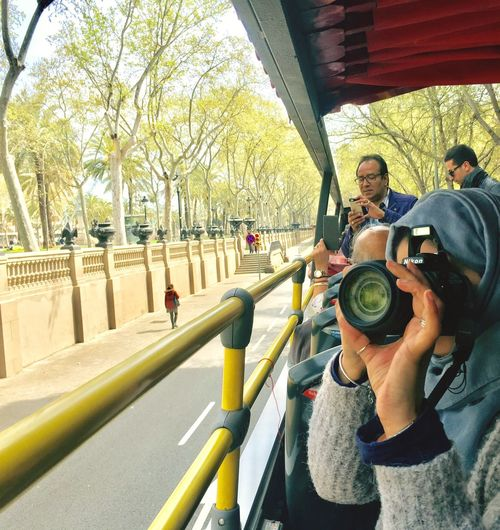 Portrait of people photographing against trees