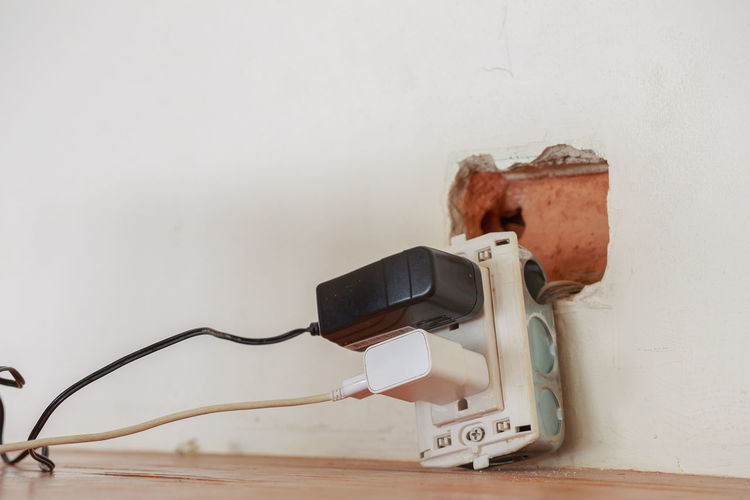 Close-up of electrical outlet by wall