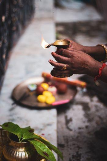 Hands holding diya oil lamp
